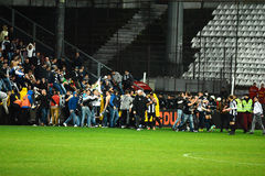 Football hooligans invasion on the soccer field Stock Photo
