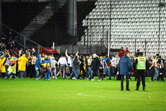 Football hooligans run on the soccer field Royalty Free Stock Photos