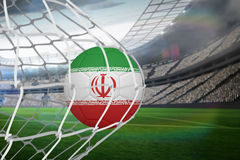 Football in iran colours at back of net Royalty Free Stock Photography
