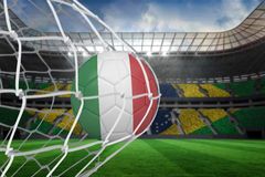 Football in italy colours at back of net Stock Photography