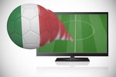 Football in italy colours flying out of tv Stock Image