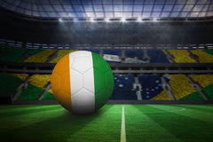 Football in ivory coast colours. In large football stadium with brasilian fans vector illustration