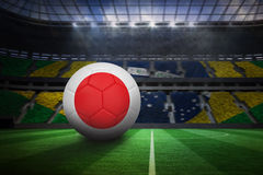 Football in japan colours. In large football stadium with brasilian fans royalty free illustration