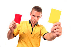 Football judge with card. A football judge with red and yellow card Stock Photos