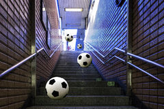 Football jumping down steps. In subway stock image