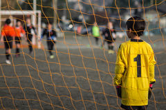 Football keeper. Kid football keeper watching the game royalty free stock photography