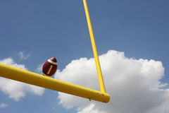 Football kicked through the Goal Posts. American Football kicked through the Goal Posts or Uprights Royalty Free Stock Photo