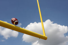 Football kicked through the Goal Posts. American Football kicked through the Goal Posts or Uprights Royalty Free Stock Image