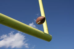 Football kicked through the uprights. American football being kicked through the uprights or goalposts Royalty Free Stock Images