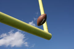 Football kicked through the uprights Royalty Free Stock Image