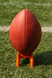 Football on a kicking tee Royalty Free Stock Photo