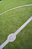Football kickoff. The center circle of a soccer field wide angle shot Royalty Free Stock Photography