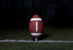 Football Kickoff on dark background Stock Photos