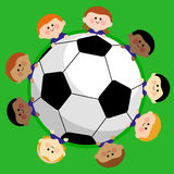 Soccer ball and kids soccer team Royalty Free Stock Images