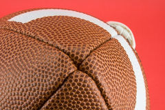 Football laces. A football on a red background royalty free stock photos