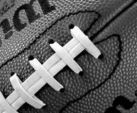 Football laces. Black and white close up of an american football Royalty Free Stock Photo