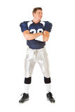 Football: Laughing Player Looks to Side. Caucasian American football player, in uniform, isolated on white, with various related props Royalty Free Stock Photo