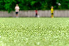 Football lawn, three player in background Royalty Free Stock Photo