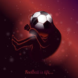 Football is life saying quote illustration with fetus on uterus and soccerball head on dark background. Royalty Free Stock Photos