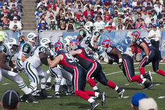 Football Line Rush. The Buffalo Bills Defense charges against the NY Jets Offenisve line during a game royalty free stock photos
