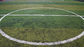 Football lined green grass field at kick off royalty free stock images