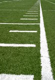 Football Lines. Green football field with large yard markers Royalty Free Stock Image