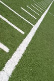Football Lines. Green football field with large yard markers Royalty Free Stock Photography