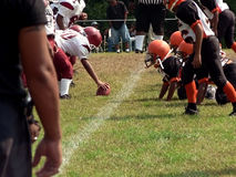 Football - little league football. Photo of little league football players of opposing teams facing off on the field royalty free stock photo