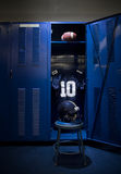 Football Locker. An open locker with a jersey, helmet and ball in a authentic football locker room. Ready for the game to start stock images