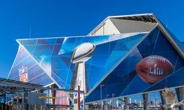 Football Logos on Mercedes-Benz Stadium. ATLANTA, GEORGIA - January 21, 2019: Superbowl LIII will be played at Atlanta`s Mercedes-Benz Stadium on Sunday stock photography
