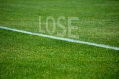 Football Lose text on grass with white lane Stock Image