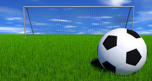 Football on a lush green field Royalty Free Stock Image