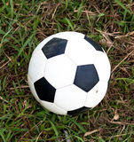 Football. Lying on the nature grass Stock Photo