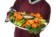 Football: Man Carrying Big Tray Of Hot Wings Royalty Free Stock Photography