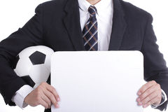 Football manager hold ball for command player Royalty Free Stock Photo