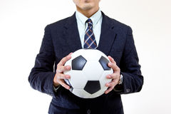 Football manager hold ball with his hands Stock Photos