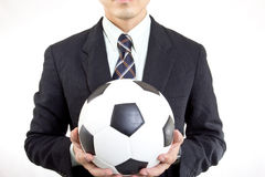 Football manager hold ball. With his hands in studio Stock Photo