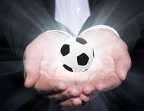 Football manager hold ball Stock Image