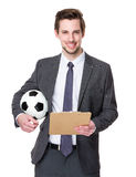 Football manager hold with clipboard and soccer ball Royalty Free Stock Photography