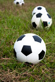 Football. Many football lying on the nature grass Royalty Free Stock Photo