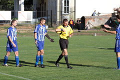 Football match. Breach of the rules Stock Photo