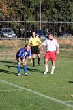 Football match. Breach of the rules Stock Photography