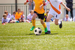 Football match for children. Boys playing football Royalty Free Stock Photo