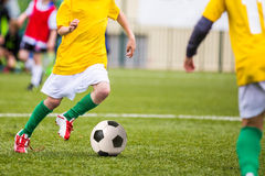 Football game for kids children. Boys playing football. Football match for children. Training and football soccer tournament Royalty Free Stock Images