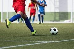 Football match for children. Soccer teams school tournament Stock Photo