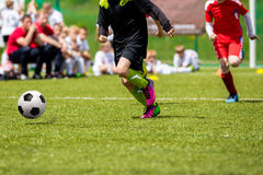 Football match for children. Training and football soccer tourna. Ment Stock Photo