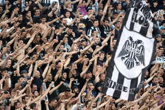 Football match between Paok and AEK. THESSALONIKI, GREECE - MARCH 16: Fans and supporters of PAOK team in football match between Paok and AEK cheering for their Royalty Free Stock Image