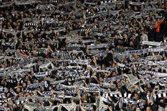 Football match between Paok and AEK. THESSALONIKI, GREECE - MARCH 16: Fans and supporters of FC PAOK cheer their team before the match against AEK on March 16 Royalty Free Stock Photos