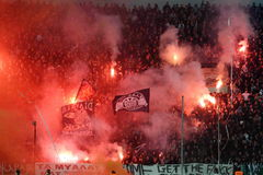 Football match between Paok and Panathnaikos. THESSALONIKI, GREECE - OCT 30: Fans and supporters of PAOK team light flares in football match between Paok and Stock Image