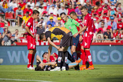 Football match. Some players lie on the field during the Spanish Second Division League match between Girona FC and CD Lugo, final score 1 - 1, on June 7, 2015 royalty free stock images